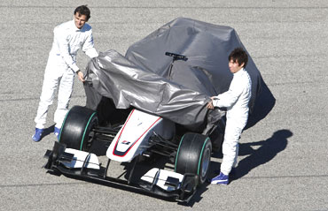 Pedro de la Rosa and Kamui Kobayashi unveil the new car