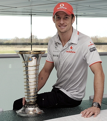 Jenson Button with the Formula One trophy
