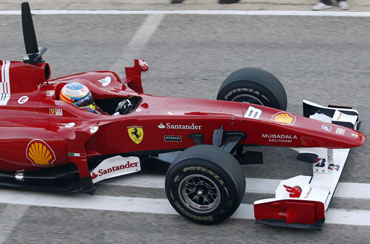 Fernando Alonso drives Ferrari