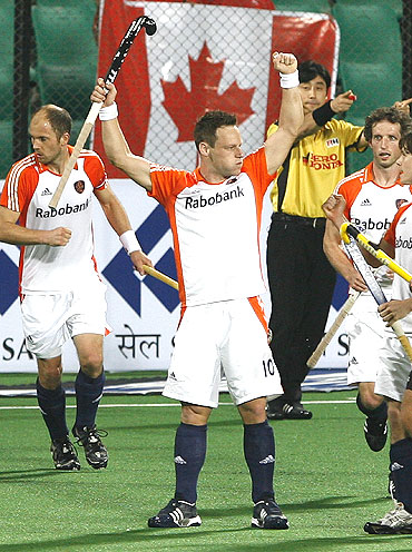 Dutchman Taekema (centre) celebrates with team-mates after scoring the first goal