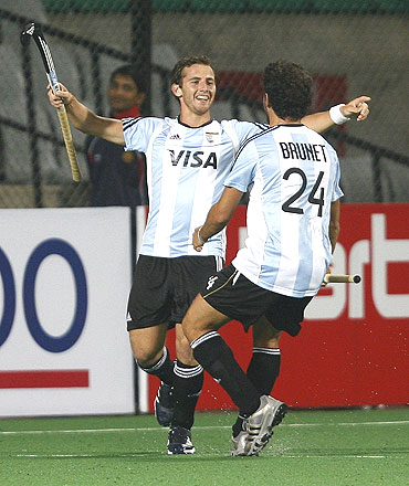 Argentina's Lucas Martin Vila (left) celebrates with team-mate Manuel Brunet after scoring