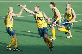 Luke Doerner celebrates with his teammates Hammond, Ockenden, and Butturini during their match against Spain