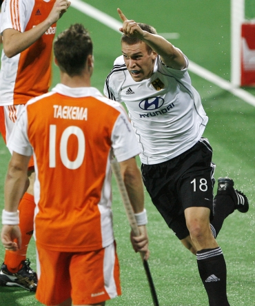 Germany's Korn celebrates after scoring as Netherlands' Taekema watches on