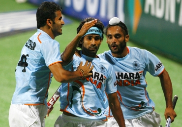 Shivendra Singh (centre) celebrates with his team mates after scoring against South Africa
