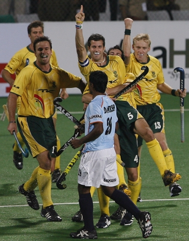 South Africa's captain Austin Smith (5) celebrates with his team-mates after scoring the third goal