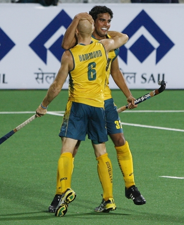 Australia's Desmond Abbott celebrates with his team-mate Hammond