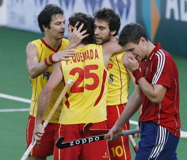 Spanish players react after their win against England