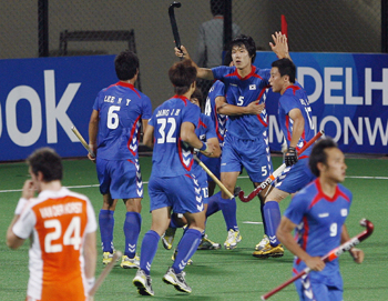 South Korea's Nam celebrates with his teammates after scoring the first goal during their match against the Netherlands