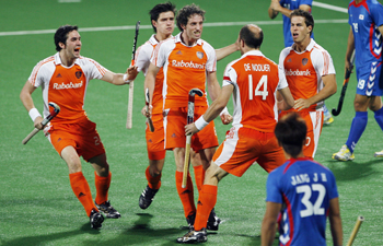 The Netherlands' Ronald Brouwer celebrates with his teammates after scoring the first goal during their match against South Kore