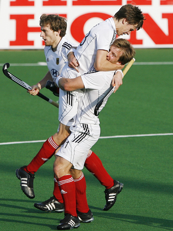 Germany's Menke celebrates after scoring the first goal during their match against New Zealand at the men's Hockey World Cup