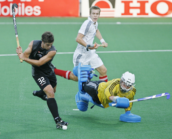 New Zealand's Wilson scores a goal as Germany's goalkeeper Jessulat unsuccessfully attempts to stop it