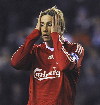 Fernando Torres reacts after missing a goal-scoring opportunity