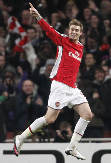 Nicklas Bendtner celebrates after scoring against Porto