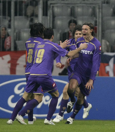 Fiorentina players celebrate a goal