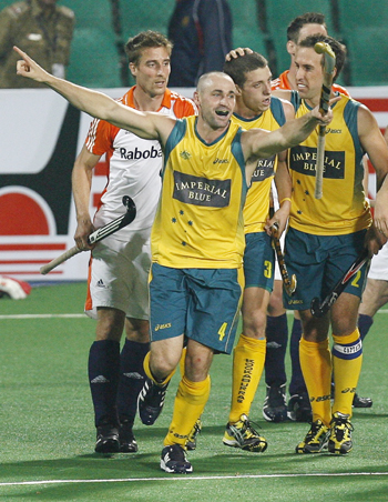 Australia's Glenn Turner celebrates scoring his goal against the Netherlands with team mates during their semi-final match