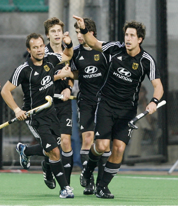 Germany's Jan-Marco Montag (right) celebrates scoring a goal against England with team mates during their semi-final match in the men's Hockey World Cup in New Delhi