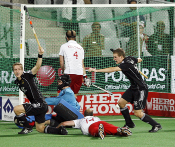 Germany's Linus Butt (left) and team mate Oliver Korn (right) celebrate after Butt scored a goal against England