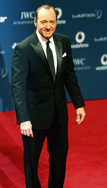 American actor Kevin Spacey poses at the red carpet as he arrives for the Laureus World Sports Awards