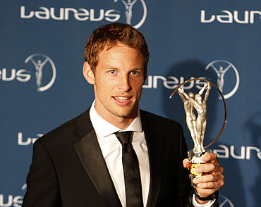 British Formula One driver Jenson Button poses with his Breakthrough of the Year award