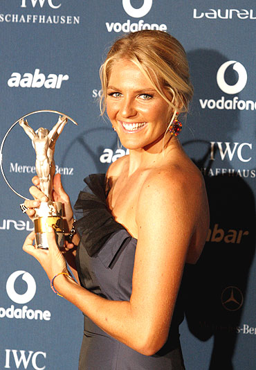 Australian surfing champion Stephanie Gilmore poses with her World Action Sportsperson of the Year award