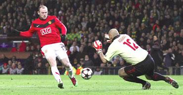 Wayne Rooney scores past AC Milan's Christian Abbiati