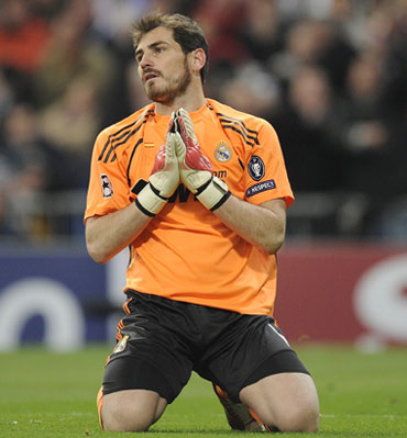 Iker Casillas reacts after conceding a goal