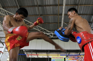 Blind boxer Salee practises with his trainer at a boxing camp