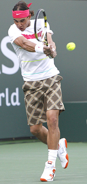 Rafael Nadal plays a return against Rainer Schuettler during their second round match at Indian Wells