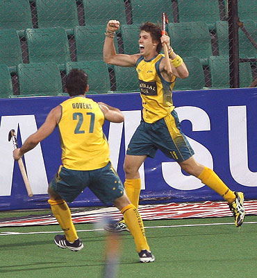 Australia's Eddie Ockenden celebrates with team-mate Kieran Govers (left) after scoring the first goal