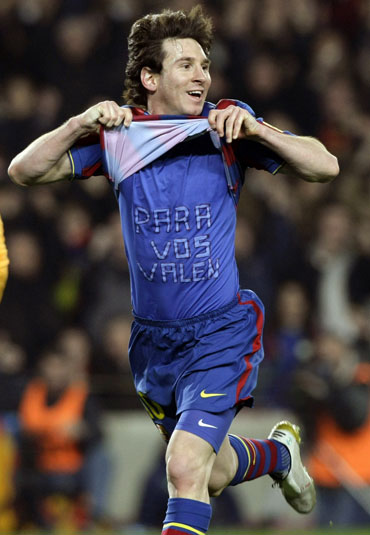 Messi celebrates after scoring a hat-trick against Valencia