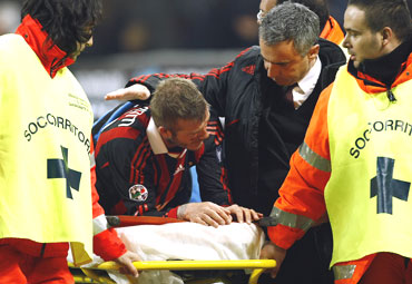 David Beckham taken off the field on a stretcher