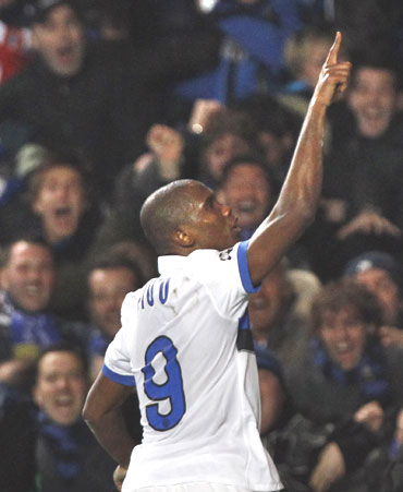 Samuel Eto'o celebrates after scoring