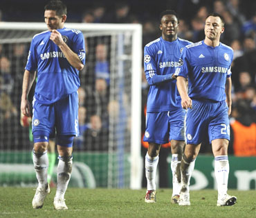 Chelsea players dejected after losing the second leg match