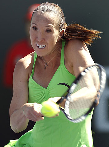 Jelena Jonkovic hits a return against Alisa Kleybanova