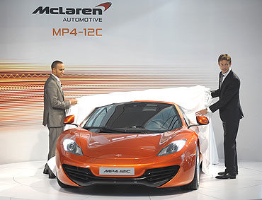 Lewis Hamilton (left) and Jenson Button unveil the new McLaren Automotive MP4-12C car
