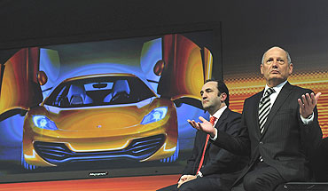 McLaren Automotive executive chairman Ron Dennis (right) and managing director Antony Sheriff address the media during the unveiling of the car