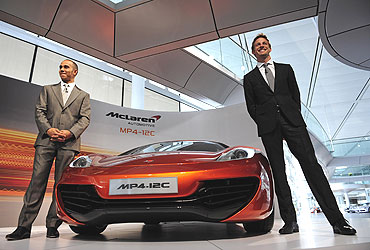 Lewis Hamilton (L) and Jenson Button with the McLaren Automotive MP4-12C