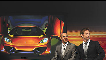 Lewis Hamilton (left) and Jenson Button speak during the car launch