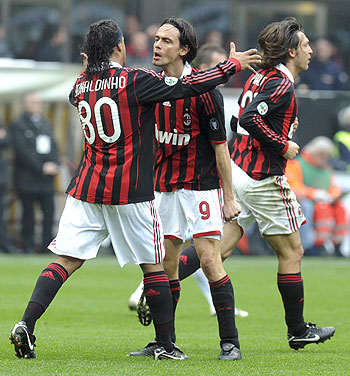 AC Milan's Filippo Inzaghi (centre) celebrates with his teammates Ronaldinho (left) and Andrea Pirlo