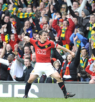 manchester united's gary neville celebrates after defeating liverpool