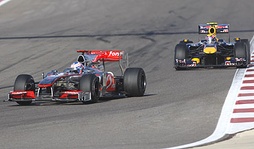 McLaren's Jenson Button leads Red Bull's Mark Webber during the Bahrain GP