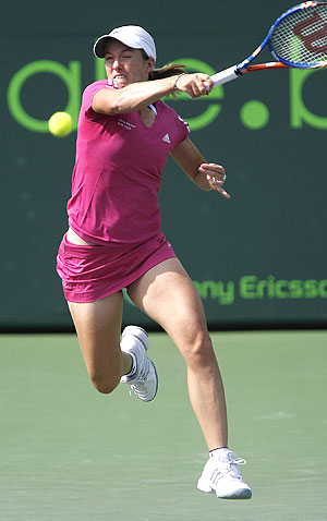 Belgium's Justine Henin hits a return during her match against Jill Craybas in round one of the Sony Ericsson Open tennis tournament match in Key Biscayne, Florida