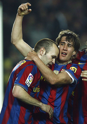 Barcelona's Bojan Krkic (right) and Andres Iniesta celebrate the second goal against Osasuna