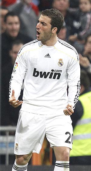 Real Madrid's Gonzalo Higuain celebrates his goal against Atletico Madrid
