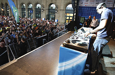 Jamaican Sprinter Usain Bolt plays DJ as he entertains the crowd at Zurich railway station