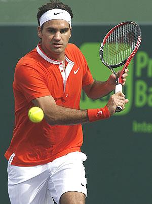 Roger Federer plays a return