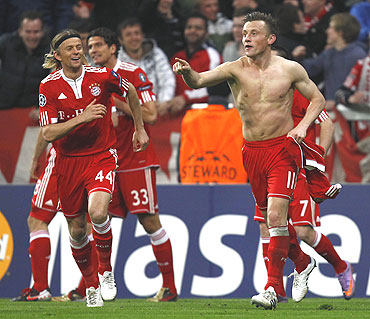 Bayern Munich's Ivica Olic (right) celebrates after scoring against Manchester United