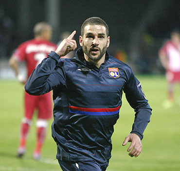 Olympique Lyon's Lisandro Lopez celebrates after scoring against Girondins Bordeaux