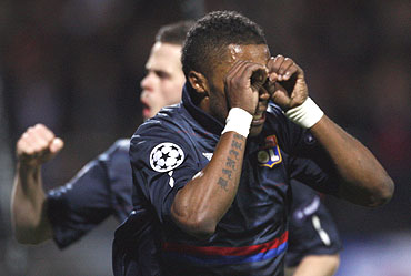 Olympique Lyon's Michel Bastos (right) celebrates after scoring against Bordeaux