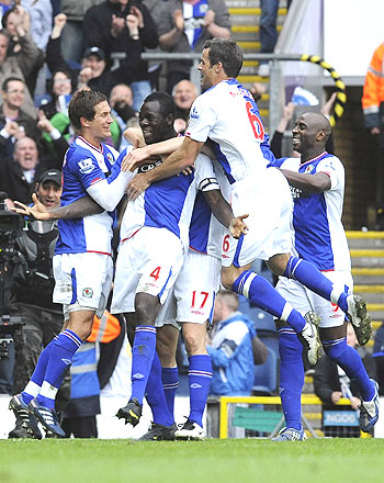 Blackburn Rovers' Chris Samba (2nd from left) celebrates with teammates after scoring against Arsenal